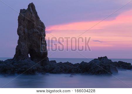 Rocky seacoast skyline with beautiful twilight sky background natural landscape background