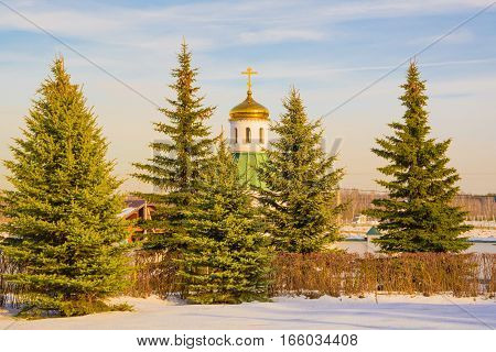 Little white chapel in the fir forest
