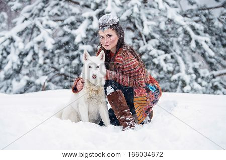 Native Indian Woman With Traditional Makeup And Hairstyle In Snowy Winter. Beautiful Girl In Ethnic