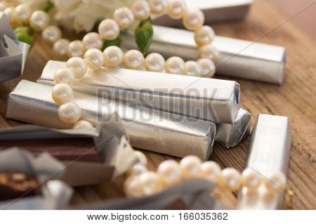 Chocolate with white flowers in foil. toned