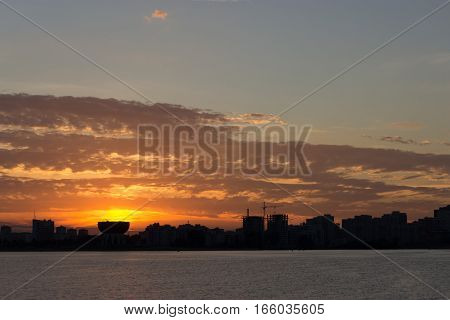 river building silhouettes beautiful orange sunset, clouds
