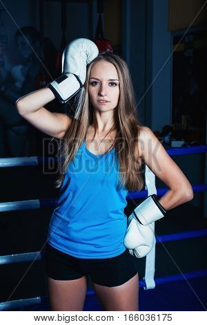 Attractive Young Woman With White Boxing Gloves Posing At The Boxing Ring.
