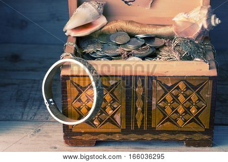 wooden box with treasures and treasure map