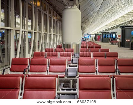 Hong Kong, China - Oct 30, 2016: Inside Hong Kong International Airport - departure level. Rows of seats for waiting passengers in one of the departure lounges. This one being currently shown as empty.