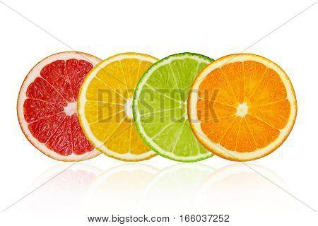 Pieces of pink grapefruit lemon lime orange isolated on white background