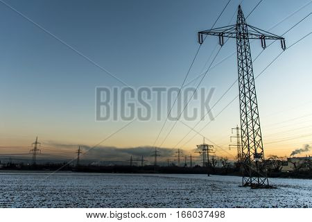Winter electric wire power lines steel tower landscape Snow white sunset sunrise dawn