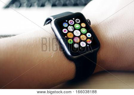 Black smart watches in the hands of