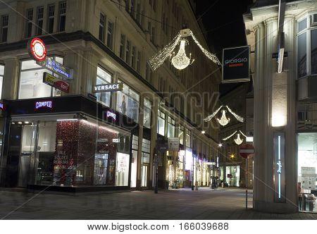 VIENNA, AUSTRIA - JANUARY 3 2016: Night view of Graben street corner with Tratternhof in Vienna during Christmas holiday long exposure shot