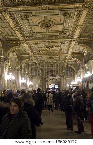 VIENNA, AUSTRIA - JANUARY 2 2016: People in the entrance hallway of Vienna Opera House in Vienna Austria