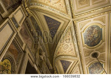 VIENNA, AUSTRIA - JANUARY 2 2016: Detail of Vienna Opera house ornamental ceiling with fresco and gold decorations