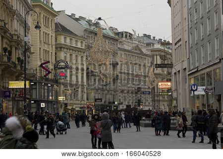 VIENNA, AUSTRIA - JANUARY 3 2016: Day view of Graben street in Vienna in the late afternoon with the light decoration on and people around