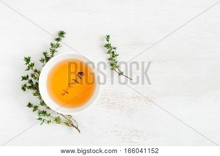 Thyme herbal tea view from high angle space for a text