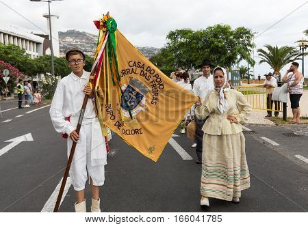 FUNCHAL MADEIRA PORTUGAL - SEPTEMBER 4 2016: Group of people in traditional costume durnig parade of Madeira Wine Festival in Funchal.Madeira Portugal
