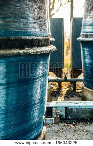 blue tank and faucet that dry and dirty old