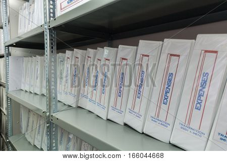 archive file folders with documents of expenses stock photo