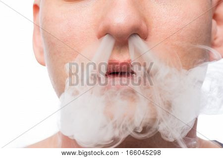 man a smoker cigarette smoke produces from the nose