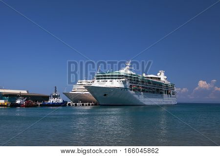 KUSADASI, GREECE - MAY 17, 2016: Two cruise ships wait for returning passengers at Kusadasi, the gateway to Ephesus.