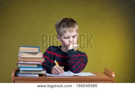 Unhappy Tired Little Boy Doing His Homework. Boring School Studies.Education Concept.
