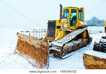 Power Shovel And Bulldozer In Snow