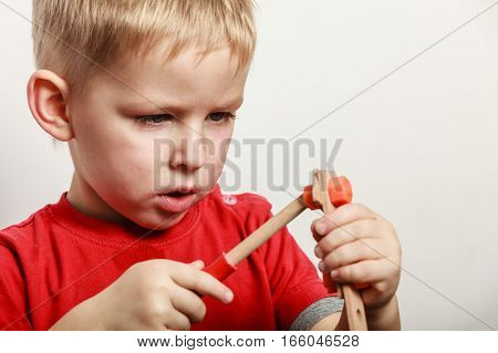 Little Boy Play With Toy On Table.