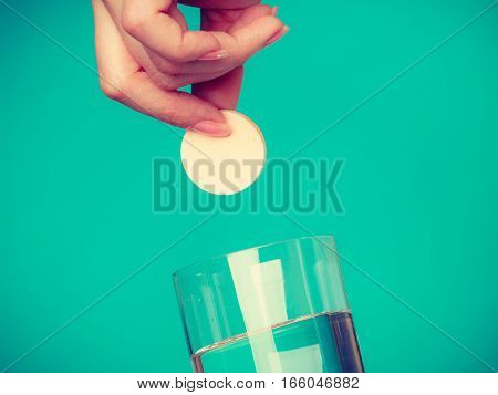 Person Holding Glass With Water And Effervescent Tablet