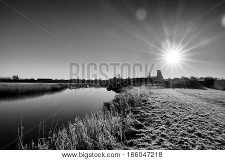 Ribe River and skyline with sun refletions