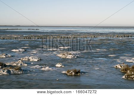 Cold winter at the National Park Wadden Sea close to island Romo causeway Denmark.