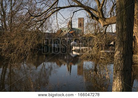 Old danish Cathedral in Royal Town Ribe. View from lake and river. Jutland Denmark.