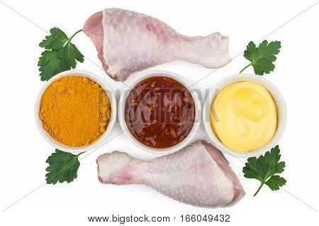 Bowls With Ketchup, Cheese Sauce, Turmeric And Raw Chicken Legs