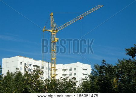 Construction of white color building in environmental place over clear sky