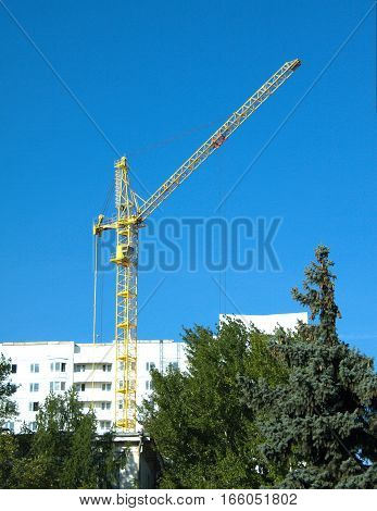 Construction of white color building in environmental place vertical view
