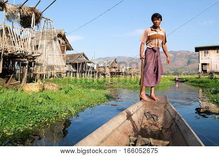 Maing Thauk (lake Inle) Myanmar - 14 January 2010: People on rowing a boat at the village of Maing Thauk on lake Inle Myanmar
