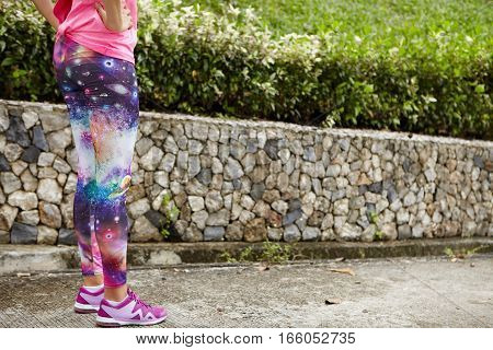 People, Sports And Determination. Cropped Portrait Of Female Runner Wearing Space Print Leggings And