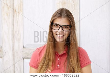 Headshot Of Beautiful Joyful Young Female Student With Long Loose Hairstyle Having Rest Indoors Afte