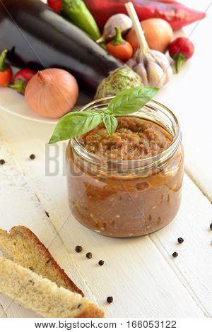 Ajvar roasted sweet pepper and eggplant (aubergine) with ingredients, vertical