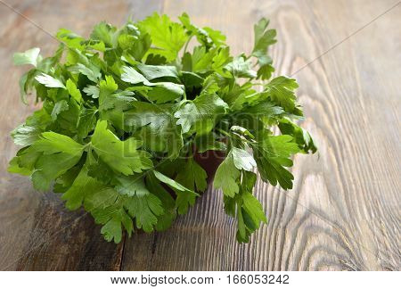 Fresh parsley on a wooden background, copy space