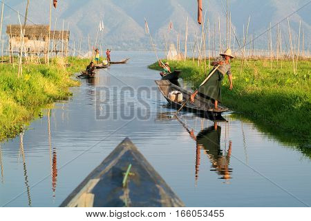 Maing Thauk (lake Inle) Myanmar - 15 January 2010: People on rowing a boat at the village of Maing Thauk on lake Inle Myanmar