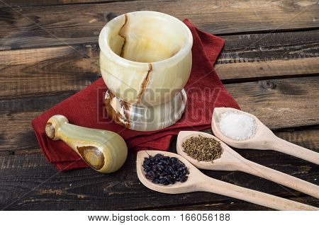 onyx Mortar and Pestle on a wooden Background