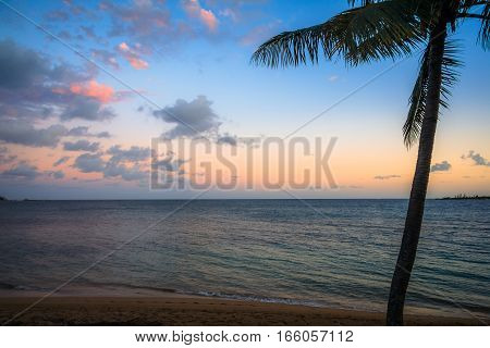 View of a beach at Noumea, New Caledonia during sunset