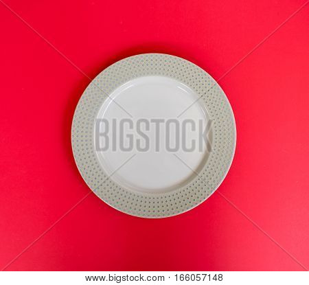 Modern empty plate pattern on red background