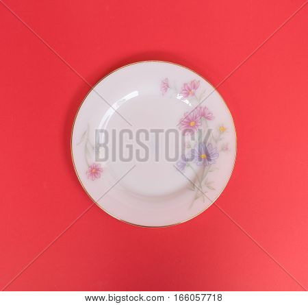 Empty dish on red background flower style