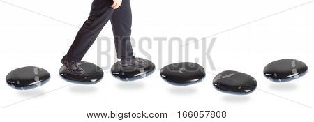 a businessman is walking on stepping stones. different concepts to illustrate business progress or obstacles.