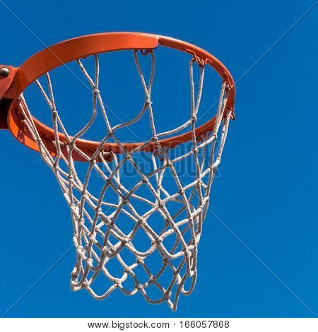 Detail of Baskeball hoop on a sunny day.