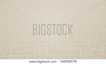 Small Paving Tiles Of A Pavement Covered By Snow
