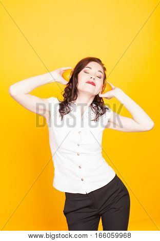 girl listens to the Orange halves as music headphones