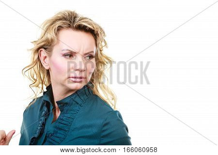 Face emotion expression. Stressful worried upset blonde woman. Middle aged unhappy elegant business female isolated on white.