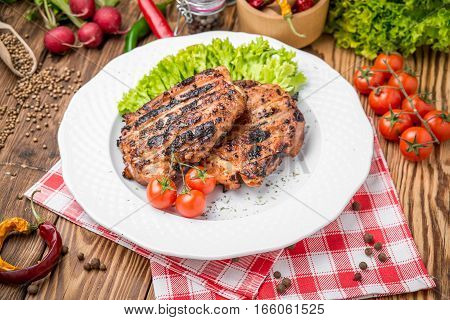 roasted chicken with herbs served on a plate with vegetables