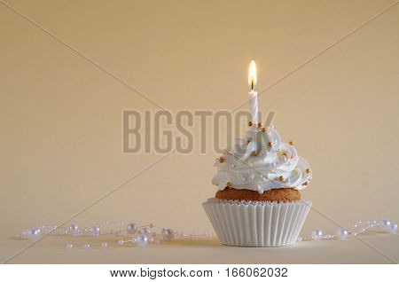 homemade birthday cake whit whipping cream and birthday candle