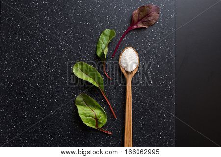 Wooden Spoon With Salt And Mint Leaves