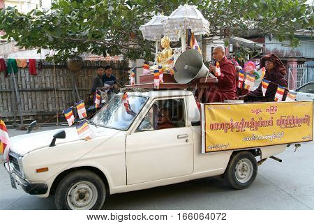 MANDALAY MYANMARMAY - 19 January 2010: monks on a car with speakers at Mandalay Myanmar.